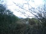Aquella casita. Al fondo se ve la silueta del Cerro de Zináparo